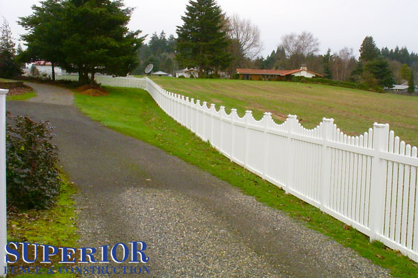 Concave vinyl fence with Gothic caps - Superior Fence