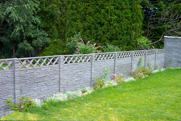 Grey stone with lattice pre-cast concrete fence - Superior Fence