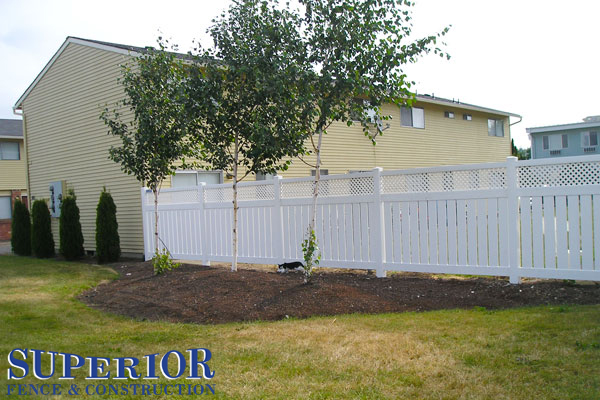Semi private lattice topped vinyl fence - Superior Fence